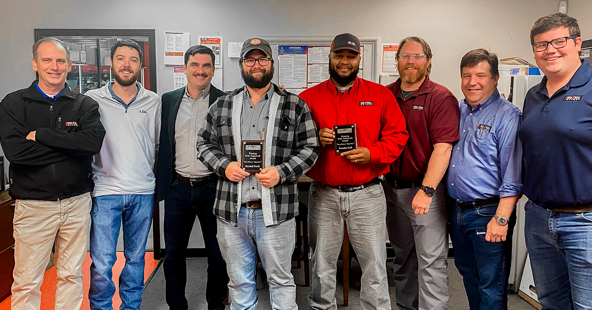 Marshall and Brandon receive Red Ball's Winning with Teamwork Award for work done during the 2021 winter storm.