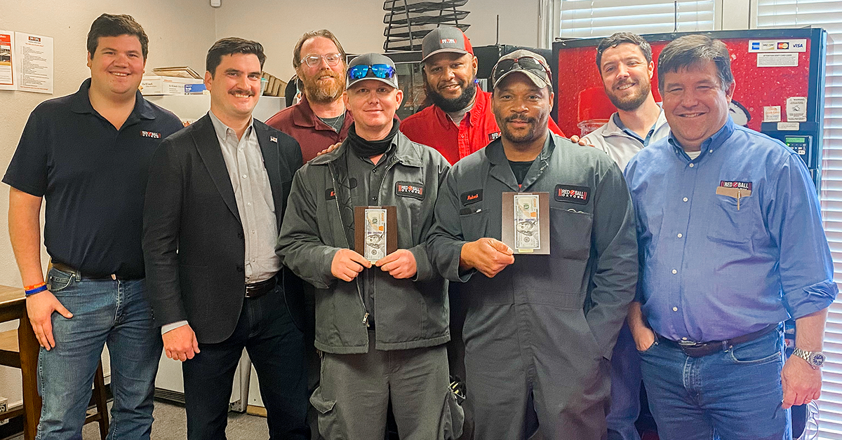 Kevin and Robert receive Red Ball's Winning with Teamwork Award for work done during the 2021 winter storm.